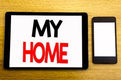 Writing text showing My Home. Business concept for House Estate Love Written on tablet laptop, wooden background with sticky note,. Writing text showing My Home royalty free stock photo