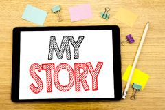 Writing text showing My Story. Business concept for Telling Tell About You Written on tablet laptop, wooden background with sticky. Writing text showing My Story Stock Photos