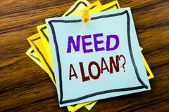 Writing text showing Need A Loan Question. Business concept for Mortage Credit written on sticky note paper on the wooden backgrou. Writing text showing Need A royalty free stock photo