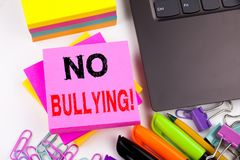 Writing text showing No Bullying made in the office with surroundings such as laptop, marker, pen. Business concept for Bullies Pr Royalty Free Stock Images