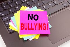 Writing text showing No Bullying made in the office with surroundings such as laptop, marker, pen. Business concept for Bullies Pr Stock Images