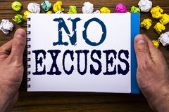 Writing text showing No Excuses. Business concept for Stop Ban for Excuse written on notepad notebook book on the wooden wood back. Writing text showing No Royalty Free Stock Images