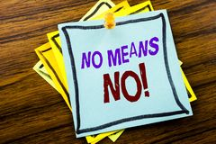 Writing text showing No Means No. Business concept for Stop Anti Rape Slogan written on sticky note paper on the wooden background. Writing text showing No Means Royalty Free Stock Photos