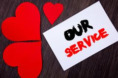 Writing text showing Our Service. Concept meaning Customer Marketing Support Help Concept Helping Your Client written on notobook. Paper note on wooden Stock Photography