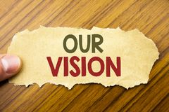 Writing text showing Our Vision. Business concept for Marketing Strategy Vision written on note paper on the wooden background wit royalty free stock photos