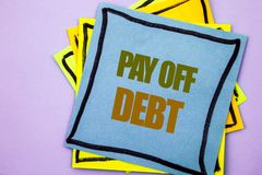 Writing text showing  Pay Off Debt. Business photo showcasing Reminder To Paying Owed Financial Credit Loan Bills written on stick. Writing text showing  Pay Off Royalty Free Stock Image