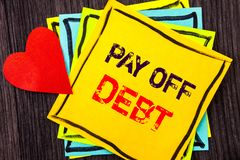 Writing text showing  Pay Off Debt. Concept meaning Reminder To Paying Owed Financial Credit Loan Bills written on Stikcy Note Pap. Writing text showing  Pay Off Royalty Free Stock Photo