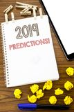 Writing text showing 2019 Predictions. Business concept for Forecast Predictive written on note paper with folded Meaning Thinking