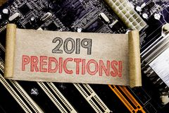 Writing text showing 2019 Predictions. Business concept for Forecast Predictive Written on sticky note, computer main board backgr