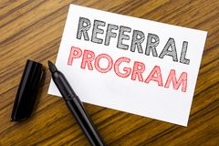 Writing text showing Referral Program. Business concept for Refer Marketing written on sticky note paper on the wooden background. Writing text showing Referral royalty free stock images