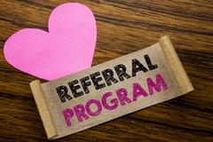 Writing text showing Referral Program. Business concept for Refer Marketing written on sticky note paper, wooden wood background. Writing text showing Referral royalty free stock photo