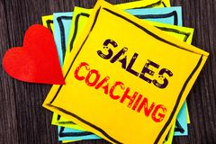 Writing text showing  Sales Coaching. Concept meaning Business Goal Achievement Mentoring written on Stikcy Note Paper on the wood. Writing text showing  Sales Stock Images