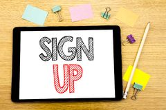 Writing text showing Sign Up. Business concept for Member Register Registration Written on tablet laptop, wooden background with s. Writing text showing Sign Up Royalty Free Stock Photos