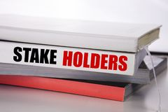 Writing text showing Stake Holders. Business concept for Stakeholder Engagement written on the book on the white background. Writing text showing Stake Holders royalty free stock photo