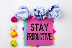Writing text showing Stay Productive written on sticky note in office with paper balls. Business concept for Concentration E. Fficiency Productivity on white royalty free stock photo