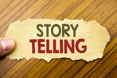 Writing text showing Storytelling. Business concept for Teller Story Message written on note paper on the wooden background with h. Writing text showing Royalty Free Stock Photo