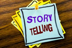 Writing text showing Storytelling. Business concept for Teller Story Message written on sticky note paper on the wooden background. Writing text showing Royalty Free Stock Photo