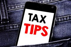 Writing text showing Tax Tips. Business concept for Taxpayer Assistance Refund Reimbursement written mobile cell phone with copy s. Writing text showing Tax Tips royalty free stock image