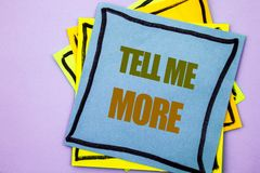 Writing text showing Tell Me More. Business photo showcasing Advice Guidance Curiosity In Coaching written on sticky note paper o. Writing text showing Tell Me royalty free stock photos