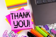 Writing text showing Thank You made in the office with surroundings such as laptop, marker, pen. Business concept for Giving Grati Royalty Free Stock Photography