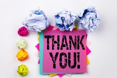 Writing text showing Thank You written on sticky note in office with screw paper balls. Business concept for Giving Gratitude Appr Stock Images