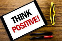 Writing text showing Think Positive. Business concept for Positivity Attitude Written on tablet laptop, wooden background with vac. Writing text showing Think royalty free stock photo