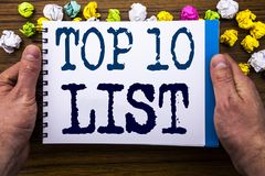 Writing text showing Top 10 Ten List. Business concept for Success ten list written on notepad notebook book on the wooden wood ba. Writing text showing Top 10 Royalty Free Stock Photos