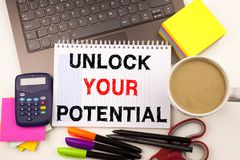 Writing text showing Unlock Your Potential made in the office with surroundings such as laptop, marker, pen. Business concept for. Self-Development Improvement Royalty Free Stock Images