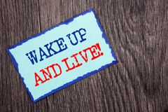 Writing text showing  Wake Up And Live. Business photo showcasing Motivational Success Dream Live Life Challenge written on Blue S. Writing text showing  Wake Up Royalty Free Stock Photography
