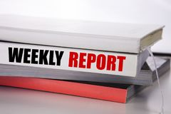 Writing text showing Weekly Report. Business concept for Analyzing Performance  written on the book on the white background. Writing text showing Weekly Report Stock Photos