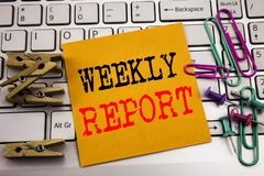Writing text showing Weekly Report. Business concept for Analyzing Performance  written on sticky note paper on the white keyboard. Writing text showing Weekly Royalty Free Stock Photos