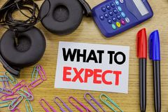 Writing text showing What To Expect. Business concept for Achieve Expectation written on sticky note paper on the wooden backgroun. Writing text showing What To Stock Photo