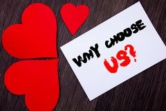 Writing text showing  Why Choose Us Question. Concept meaning Reason Of Choice Customer Satisfaction Advantage written on notobook. Paper note on  wooden Stock Photo