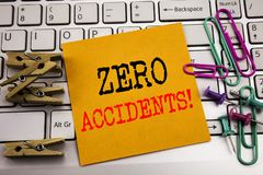 Writing text showing Zero Accidents. Business concept for Safety At Work Hazard written on sticky note paper on the white keyboard. Writing text showing Zero Stock Image