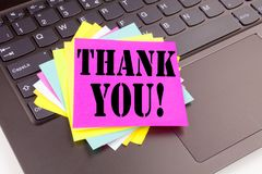 Writing Thank You text made in the office close-up on laptop computer keyboard. Business concept for Giving Gratitude Appreciate M Stock Image