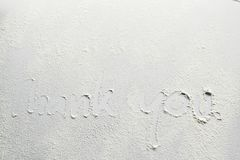 Writing `Thank you!` on the white board with wheat flour on surface royalty free stock photos
