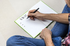 Writing to do list in note book Stock Photo