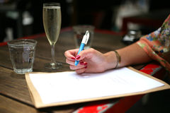 Writing a to do list with prosecco Royalty Free Stock Photo