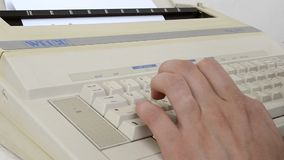 Writing to a 1980s Electric Typewriter Machine stock video