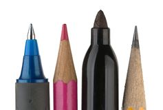 Writing Tools on White. Closeup image of a pencil, pen, felt marker and a colored pencil stock image