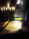 Writing the Torah. Antique Torah scrolls on a table into a little room, illuminated by a jewish chandelier and the moonlight entering by an opened window Royalty Free Stock Images