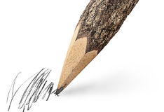 Writing unusual pencil in the form of logs Stock Images