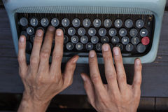 Writing with a vintage typewriter Royalty Free Stock Image