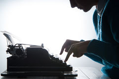 Writing vintage way. Hands writing on a vintage typewriter as a communication concept with copy space Stock Images