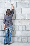 Writing on wall. Writing man on grey brick wall Royalty Free Stock Photography