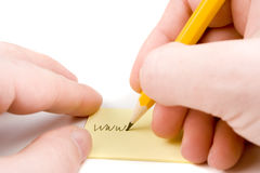 Writing web address on paper. Writing web address on yellow paper Royalty Free Stock Photo