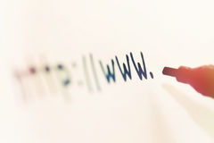 Writing website address with black marker royalty free stock photo