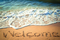Writing Welcome on the Beach Stock Photography