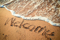 Writing Welcome on the Beach Royalty Free Stock Photos
