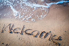 Writing Welcome on the Beach Stock Images